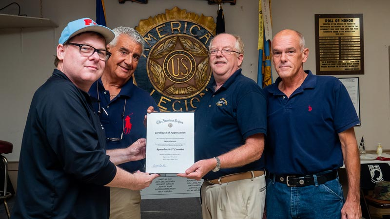 Remember the 27 Crusaders Director Sean Swords and Producer John Ricuitti accept Certificate of Appreciation from Bob Cummings and Commander Bruce Conklin